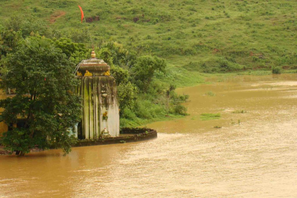 Priests swim to perform rituals in flood hit villages