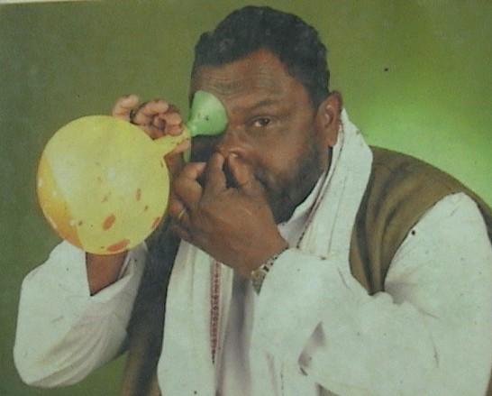 Man blows balloon with eye