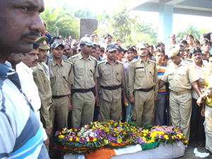 Floral tributes for asst. commandant Satpathy