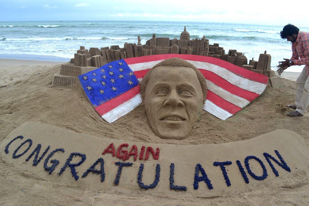 Sudarsan creates image of Obama on Puri beach